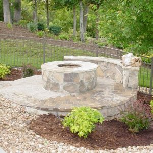 Fun Outdoor Living construction of a stone fire pit