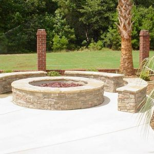 Fun Outdoor Living construction of a fire pit on paved walkway