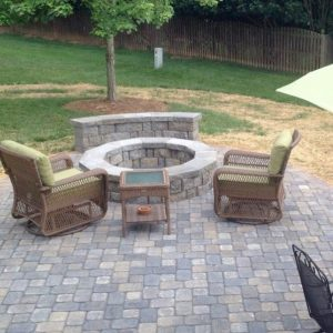 Fun Outdoor Living construction of a stone fire pit on patio