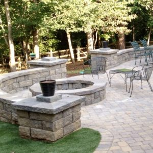 Construction of a stone fire pit on patio