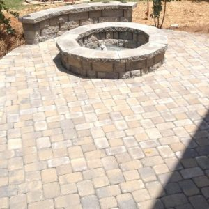 Construction of a stone fire pit by Fun Outdoor Living