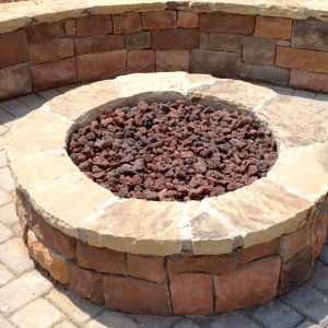 Close up of Fun Outdoor Living installation of a fire pit