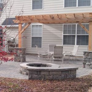 Fun Outdoor Living fire pit installed with pergola
