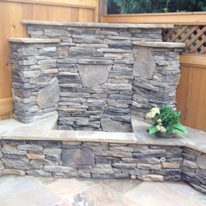 Stacked stone fire pit in backyard