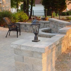Fire pit installed in a stone wall