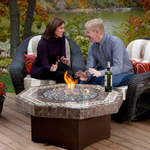 Couple sitting next to a fire table