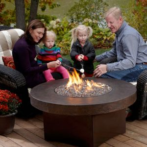 Family warming up next to a fire table