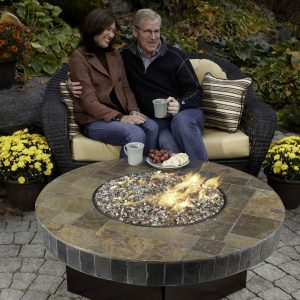 Couple next to a fire table