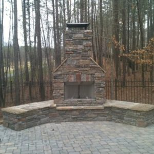 Front view of brick fireplace installation in backyard