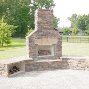 Brick and stone fireplace installation during the day