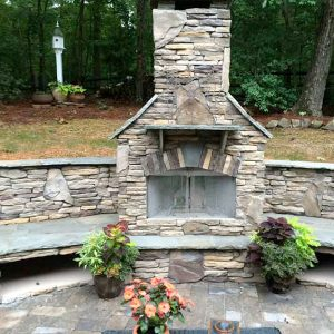 Brick and stone fireplace during the day