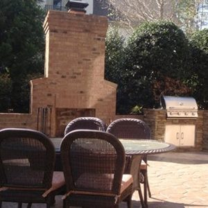 Fun Outdoor Living Brick fireplace construction and installation