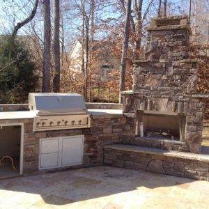 Fun Outdoor Living Brick kitchen and fireplace construction