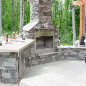 Fun Outdoor Living Brick fireplace construction with an outdoor kitchen