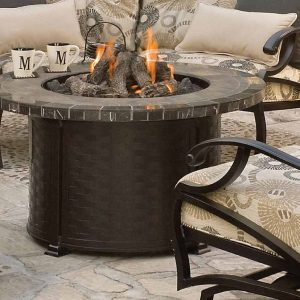Close up of a fire table and patio furniture