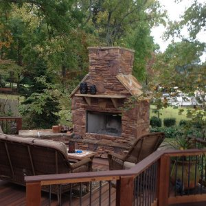 Brick and stone fireplace on deck