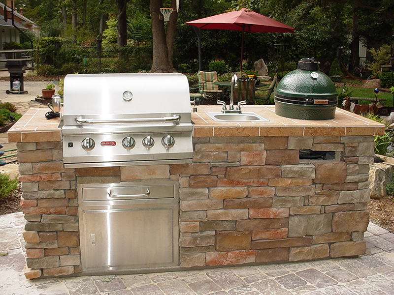 Built-in Bull grill and Big Green Egg smoker on patio
