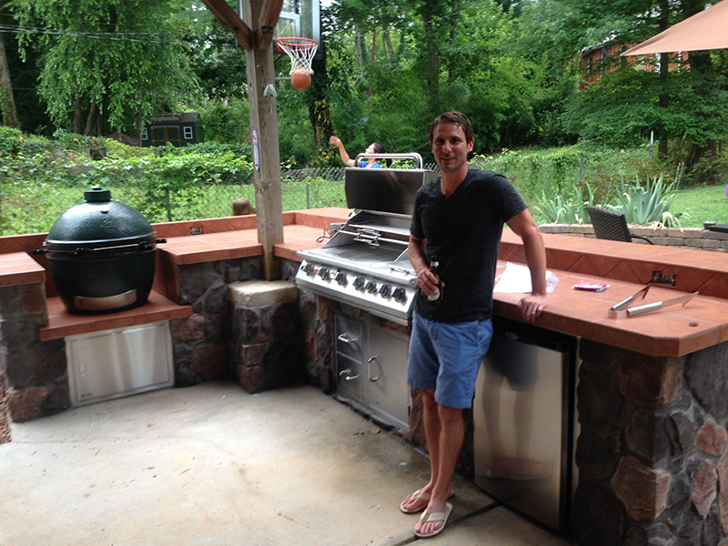 Fun Outdoor Living customer next to his built-in Bull grill in an outdoor kitchen
