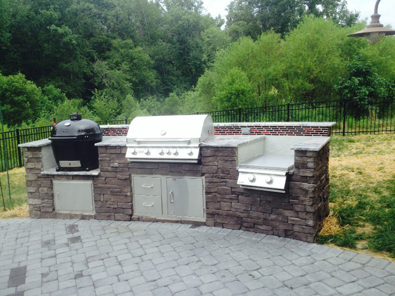 Outdoor kitchen with Big Green Egg smoker grill