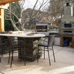 Outdoor kitchen with patio table and chairs