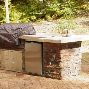 Cover over built-in grill, refrigerator and storage