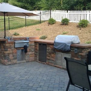 Fireplace and kitchen on outdoor patio