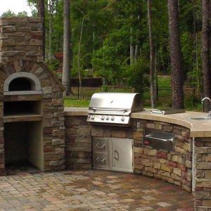 Outdoor fireplace and kitchen on patio