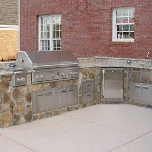 Fun Outdoor Living outdoor kitchen installation in a backyard