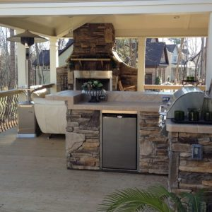 Bull built-in grill with refrigerator in outdoor kitchen