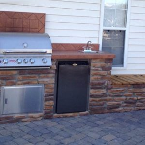 Outdoor kitchen along back of house