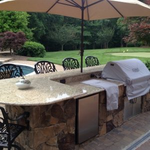 Outdoor built-in grill with kitchen and countertop