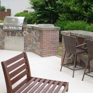 Outdoor stone kitchen with built-in grill
