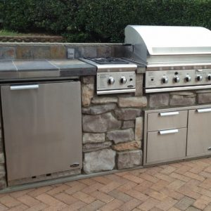 Close up of built-in grill, refrigerator and drawers