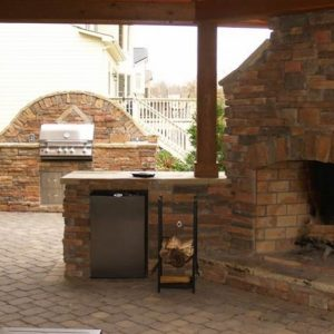 Outdoor kitchen with grill and refrigerator