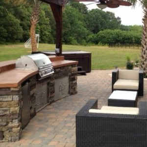 Outdoor kitchen with built-in grill and refrigeration