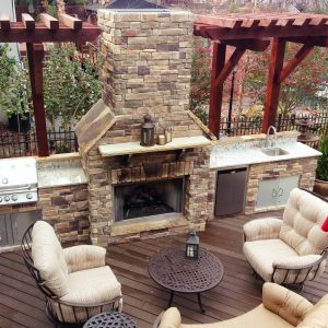 Overhead view of an outdoor kitchen and fireplace