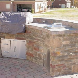 Stone kitchen island in backyard