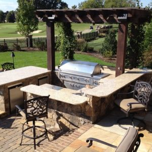 Fun Outdoor Living outdoor kitchen and pergola installation