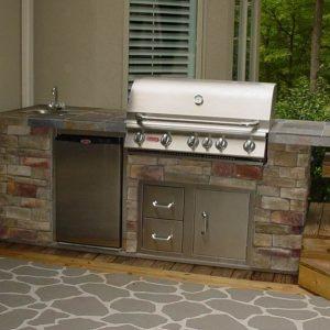 Stone BBQ grill island with refrigerator