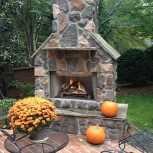 Brick and stone fireplace with pumpkins