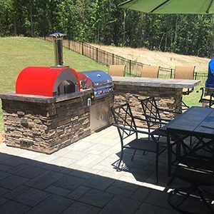 Pizza oven built into an outdoor kitchen