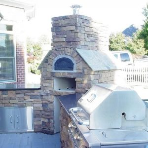 Side view of Fun Outdoor Living's installation of a pizza oven
