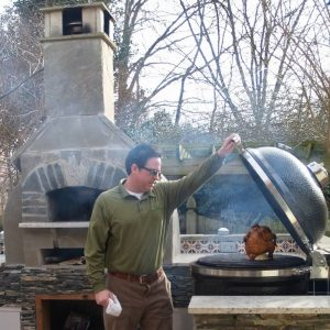 Customer opening Large Big Green Egg and pizza oven