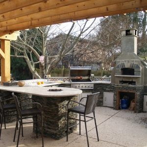 Pizza oven with an outdoor kitchen
