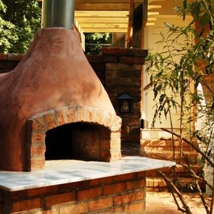 Close up of a pizza oven on patio