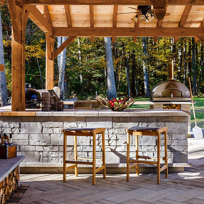 Bar and stools designed with an outdoor kitchen