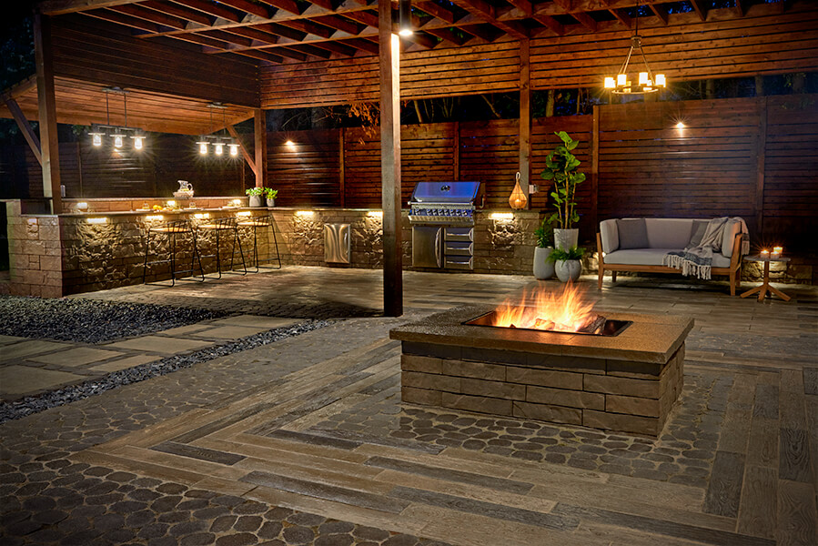 Fire pit designed in an outdoor kitchen