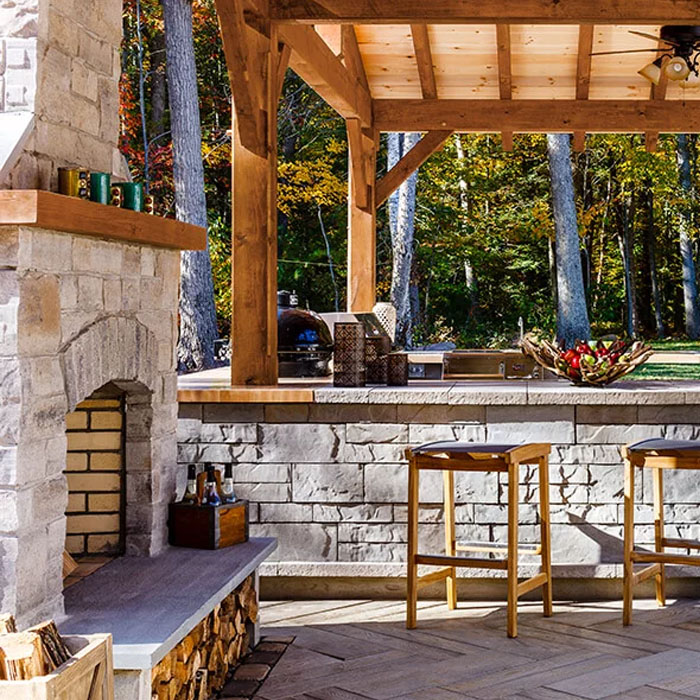 Close up of a fireplace designed in an outdoor kitchen