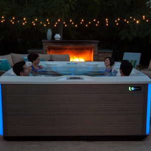 friends in hot tub with lights on