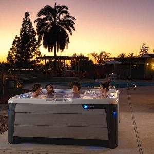 hot tub in backyard during sunset